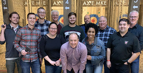 Employees at Axe Throwing Event